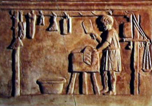 Ancient butcher and sausage maker in Roman relief